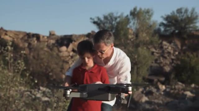 Man And Son Use Drone: Stock Video