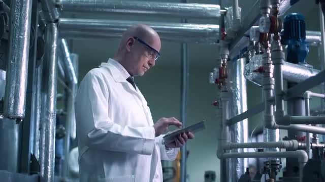 Scientist Inspecting The Valve: Stock Video