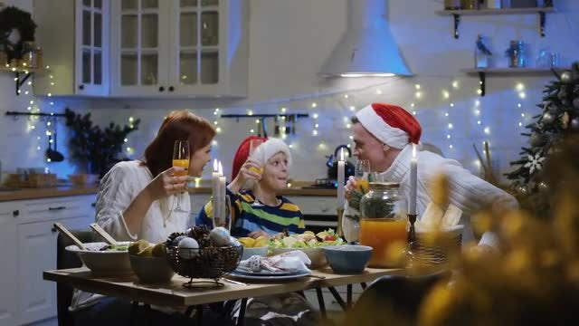 Family Around  Christmas Table: Stock Video