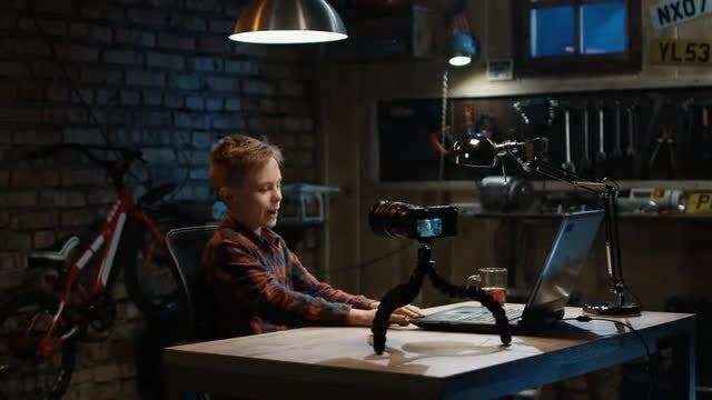 Boy Talking On Camera: Stock Video
