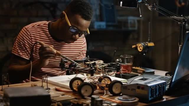 Man Repairing Broken Drone: Stock Video