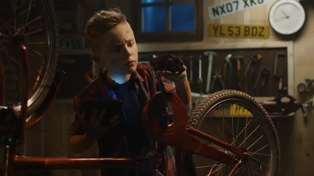 Teenage Boy Repairs Bicycle: Stock Video