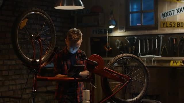 Boy Learns To Repair Bike: Stock Video