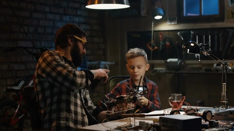 Father And Son Repair Drone: Stock Video