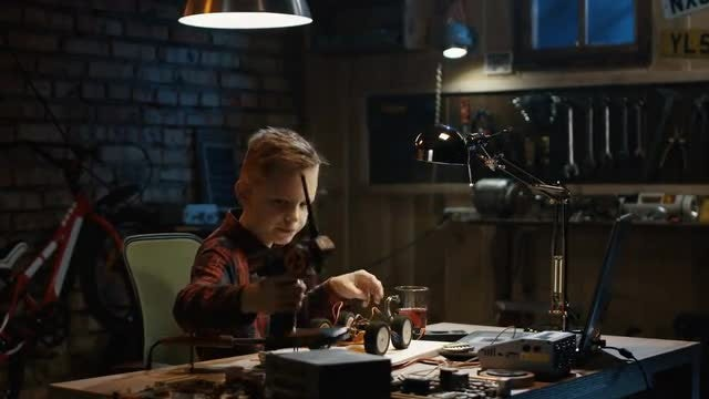 Boy Repairing Toy: Stock Video