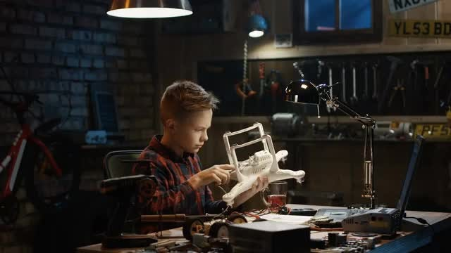 Boy Fixing Broken Drone: Stock Video