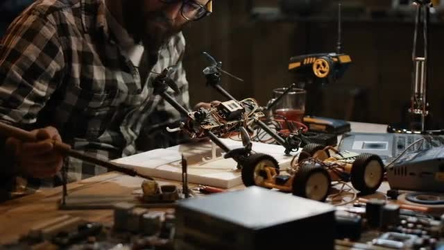 Man Soldering A Drone: Stock Video