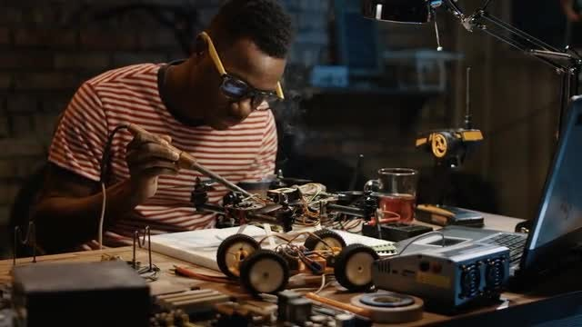 Man Repairs Drone: Stock Video