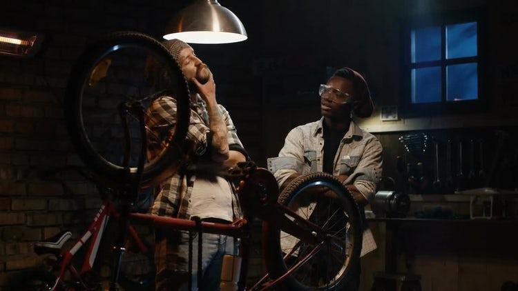 Talking In Bike Repair Shop: Stock Video