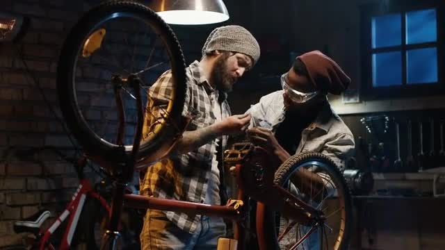 Men Repairing A Bicycle: Stock Video