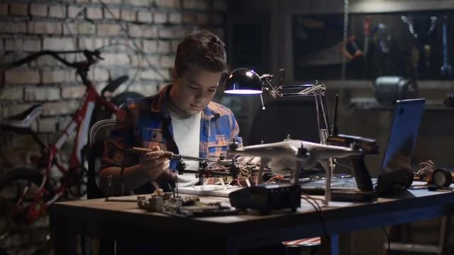 Boy Repairs Drone: Stock Video