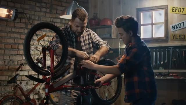 Fixing A Bicycle: Stock Video