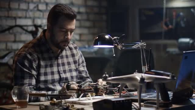 Man Solders A Drone: Stock Video