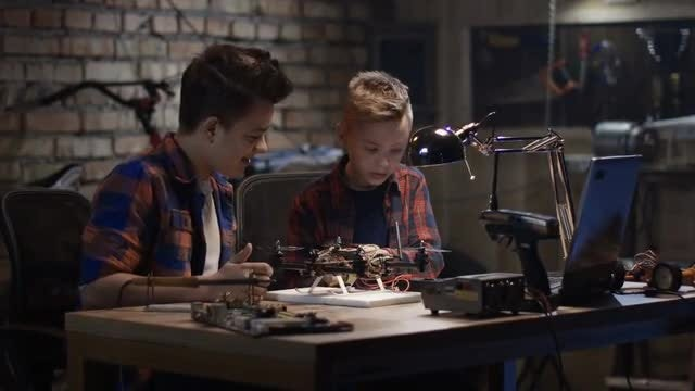 Boys Repairing A Drone: Stock Video
