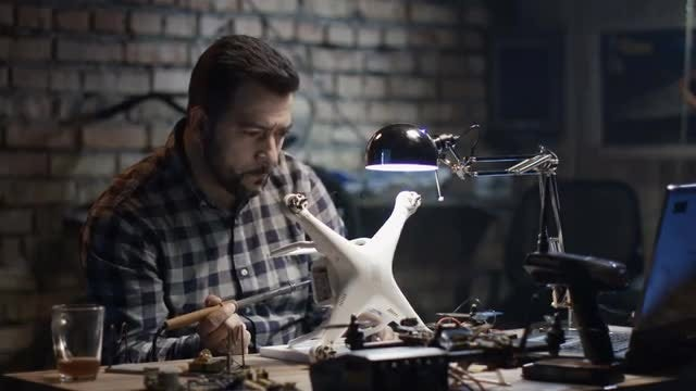 Man Fixing A Drone: Stock Video