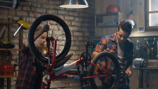 Boys Repairing A Bike: Stock Video