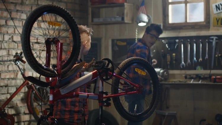 Two Boys Repair Bike: Stock Video