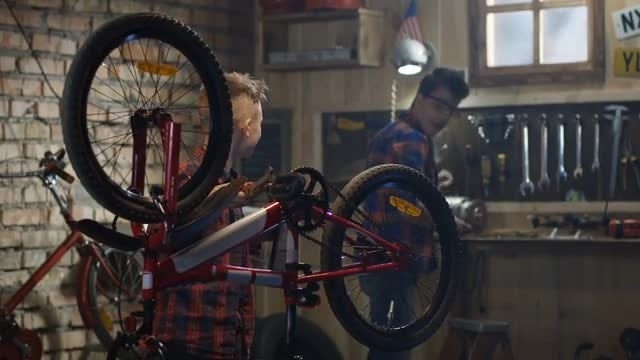 Two Boys Repair Bike: Stock Video