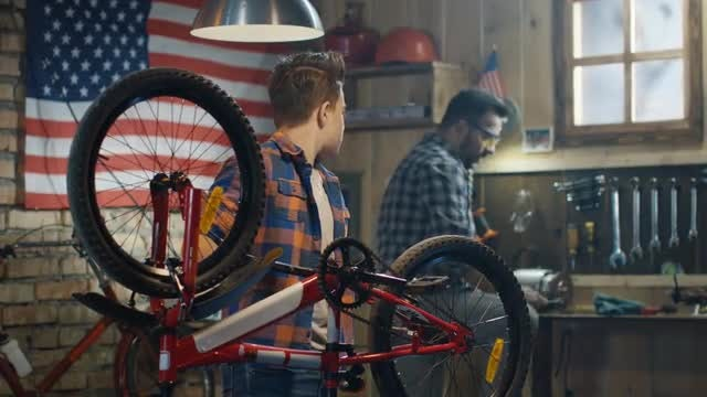 Father Helps Son With Bike: Stock Video