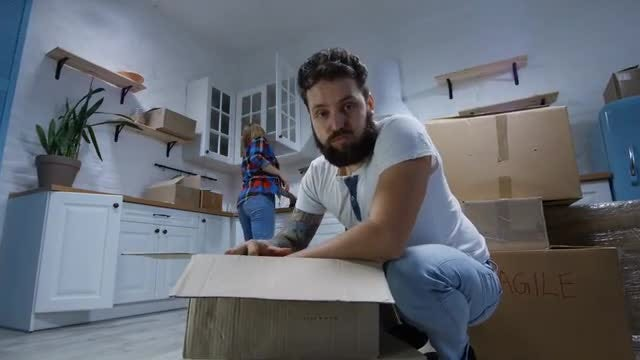 Couple Moves Into New Home: Stock Video