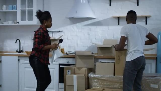 Couple Unpacks Cardboard Boxes: Stock Video