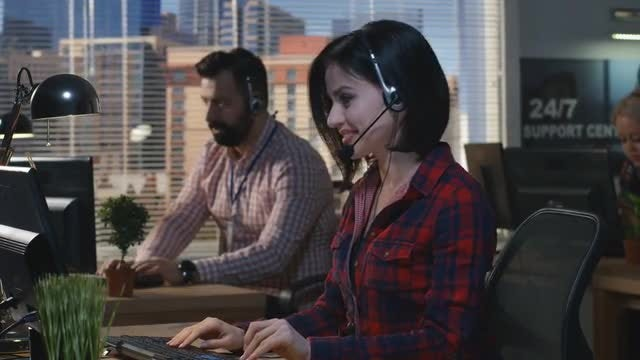 Smiling Call Center Agent: Stock Video