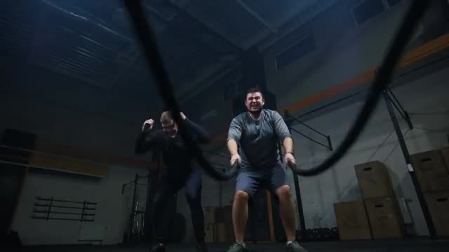 Man Training With Battle Ropes: Stock Video