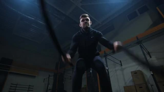 Man Exercising With Battle Ropes: Stock Video