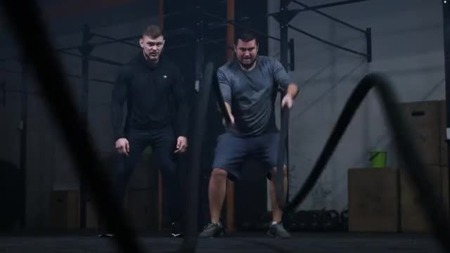 Man With Fitness Trainer: Stock Video