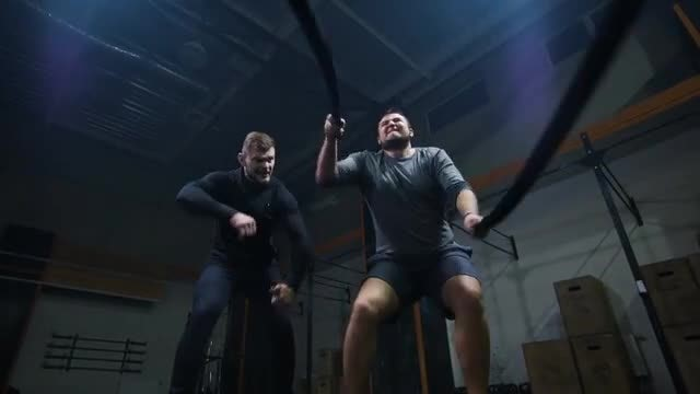 Exercising With Ropes: Stock Video