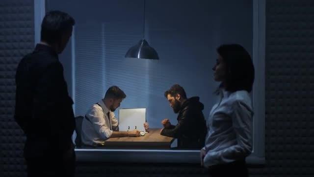 Watching An Interrogation: Stock Video