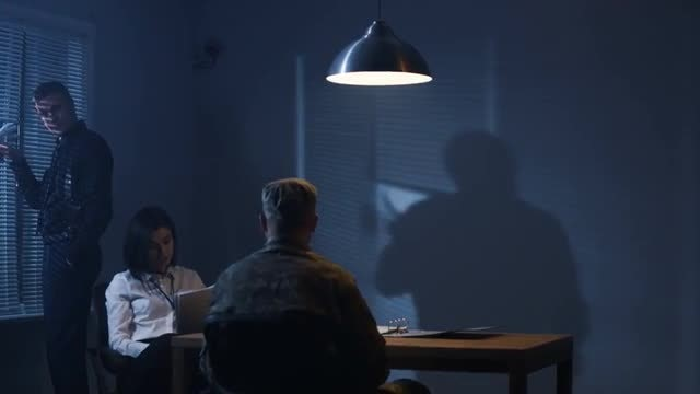 Investigators Interrogate Soldier: Stock Video
