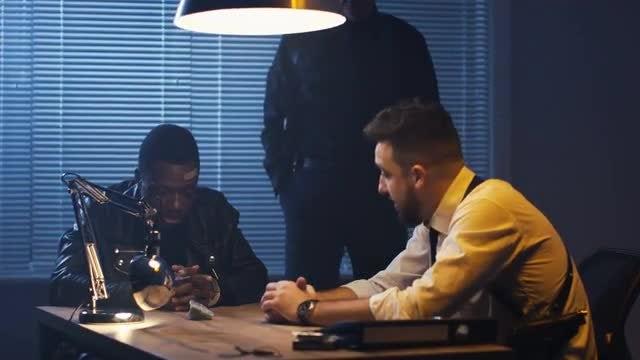 Policemen Interrogating Suspect: Stock Video