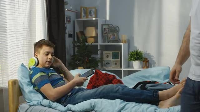 Father And Son In Bedroom: Stock Video