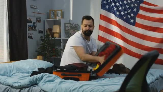 American Man Packing Suitcase: Stock Video