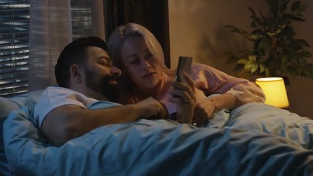 Couple Using Phones In Bed: Stock Video
