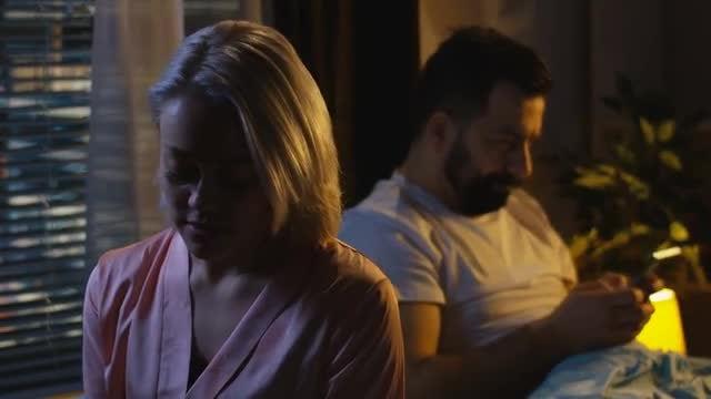 Man Ignores Upset Wife: Stock Video