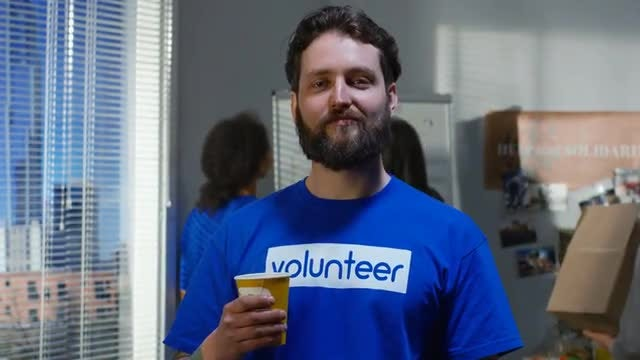 Volunteer Taking Coffee Break: Stock Video