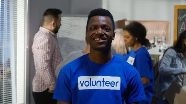Man Volunteers At Charity: Stock Video