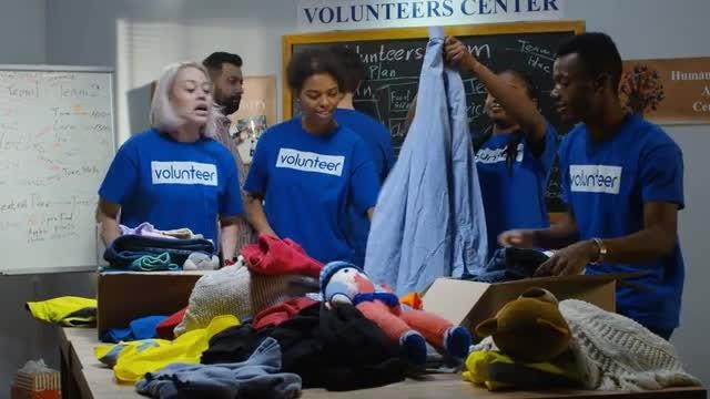 Volunteers Pack Donations: Stock Video