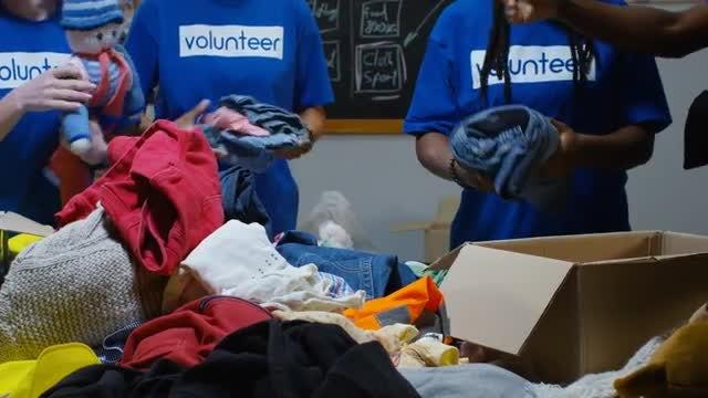 Volunteers Sort Donations: Stock Video