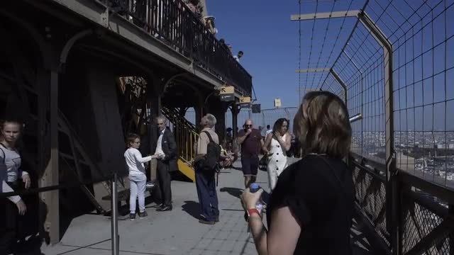 Tourists On The Eiffel Tower: Stock Video