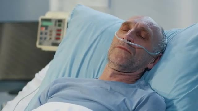 Patient In Hospital Bed: Stock Video