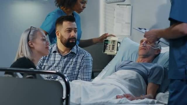 Doctor Talks To Family: Stock Video