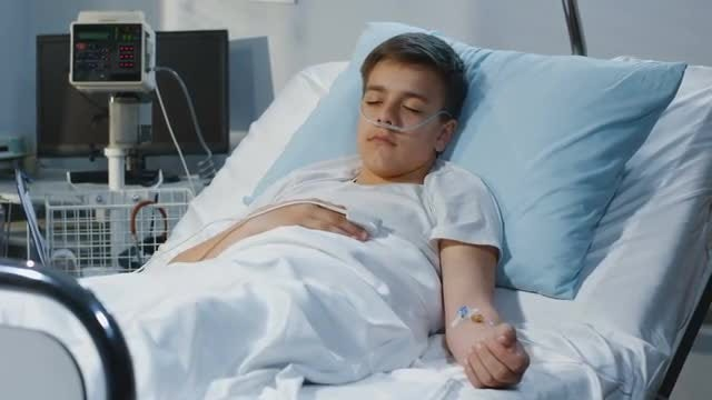 Teenager Lying In Hospital Bed: Stock Video