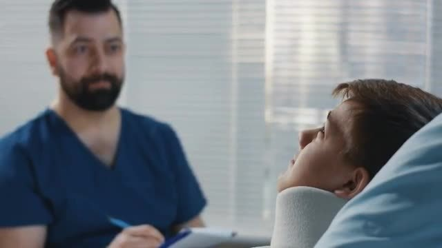 Doctor Chatting With Patient: Stock Video