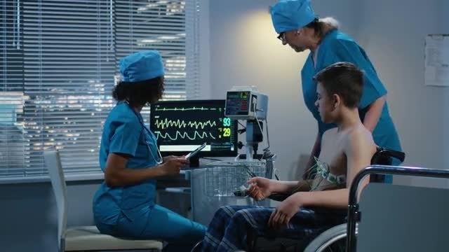 Doctors Examining Teen Patient: Stock Video