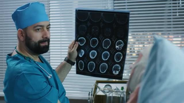 Doctor Showing Brain Scans: Stock Video