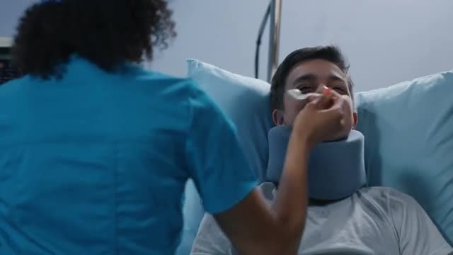 Nurse Feeding Teenage Patient: Stock Video