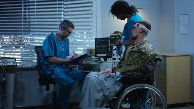 Doctors Diagnosing Injured Solider: Stock Video
